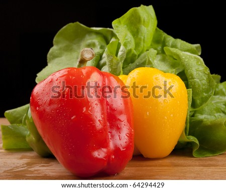 red and yellow peppers and salad - stock photo