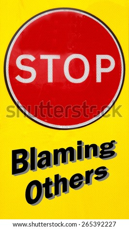 Red and yellow warning sign with a Stop Blaming Others concept - stock photo