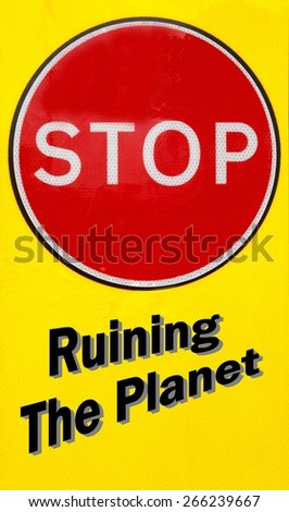 Red and yellow warning sign with a Stop Ruining The Planet concept - stock photo