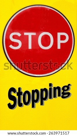 Red and yellow warning sign with a Stop Stopping concept - stock photo
