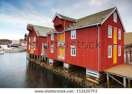 Red and yellow wooden coastal houses in Norwegian fishing village. Rorvik, Norway - stock photo