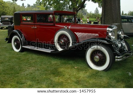 Red antique car - stock photo
