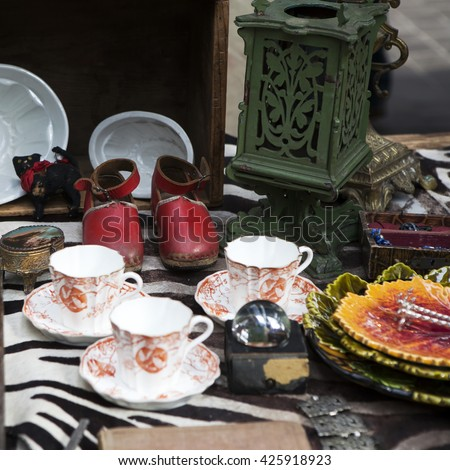red antique leather shoes among the junk on the vintage market - stock photo