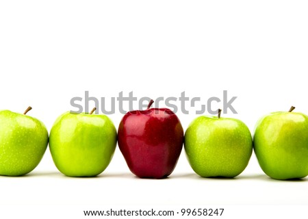 Red apple among green apples isolated on a white - stock photo