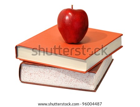 Red apple and educational science textbooks; food for the body and mind. - stock photo