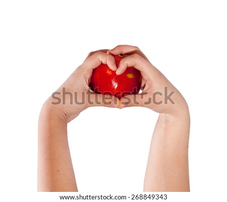 Red apple in hands heart shape concept - stock photo