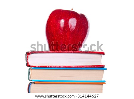 Red Apple on the Books Isolated on the White Background - stock photo