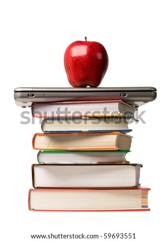 Red apple on top of laptop computer and a stack of school books. Concept of education. - stock photo