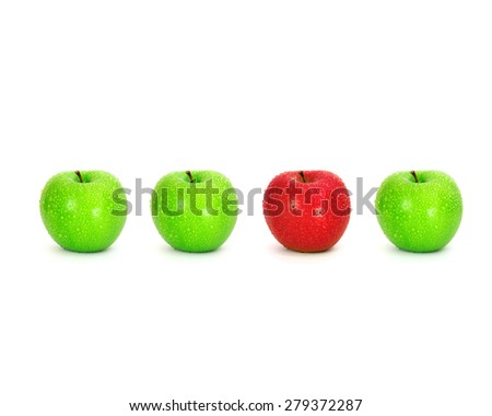 red apple place on white background among green apple with water droplet , unique or different concept - stock photo