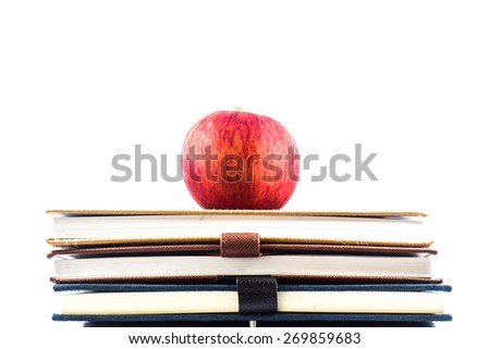 red apple sitting on top of a  school books - Concept of education. - stock photo