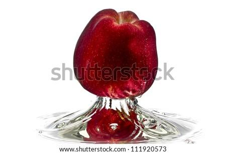 Red apple water splash with white background, high speed splash - stock photo