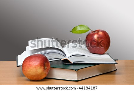 Red apples and open book - stock photo