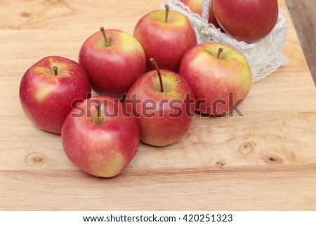 red apples is delicious on wood background - stock photo