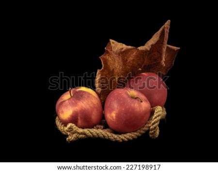 Red apples on a black background.  - stock photo