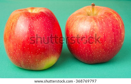 red apples on green background. - stock photo