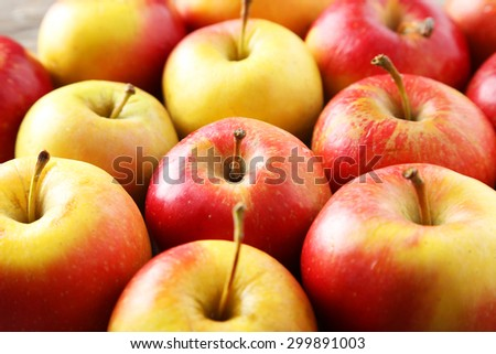Red apples on grey wooden background - stock photo