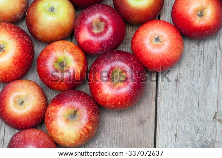 Red apples on wooden board. - stock photo