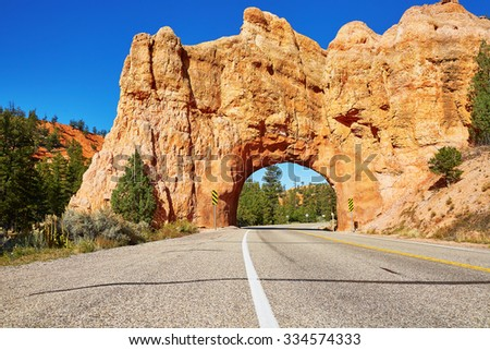 Red Arch road tunnel on the way to Bryce Canyon National Park, Utah, USA - stock photo