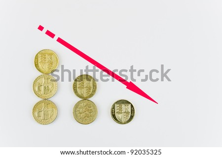 Red arrow down indicating going into the red in accounts / Falling pound coins - stock photo