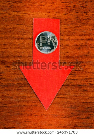 Red Arrow with Russian Ruble Down on the Wooden Background - stock photo