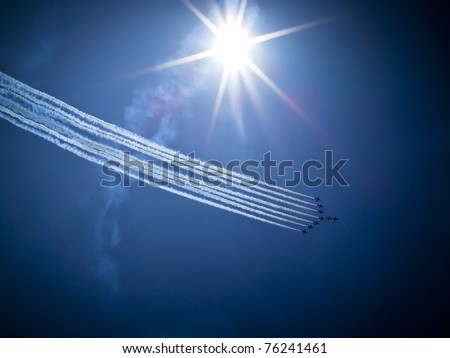Red Arrows formation at blue sky during Air Show 2009 in Radom, Poland - stock photo