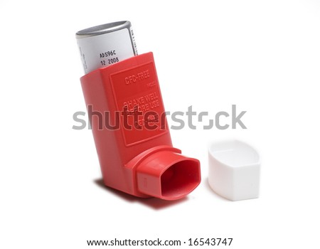 Red asthma inhaler isolated on white background - stock photo