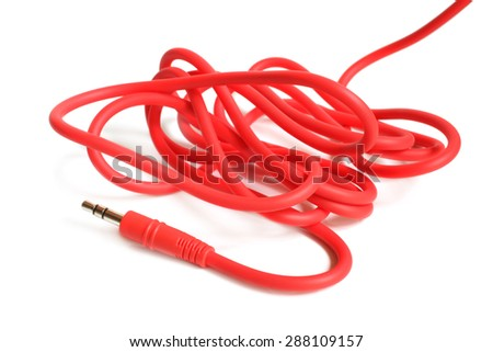 Red audio cable 3,5mm jack plug on white background - stock photo