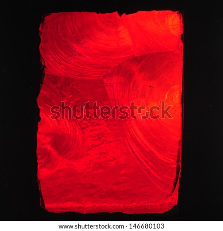 Red background: brilliant red chipped slab glass in a stained glass window in a church - stock photo