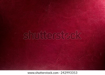 Red background illuminated from the right corner spotlight and vintage grunge background texture - stock photo