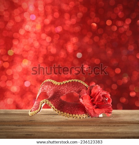 red background of lights and red mask  - stock photo