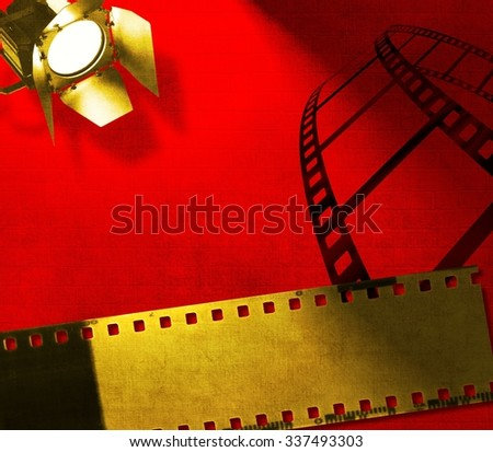 Red background with film strip and reflector - stock photo