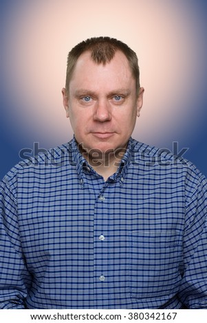 red, balding man, photo for documents. - stock photo