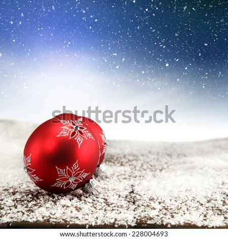 red ball and silver snow  - stock photo