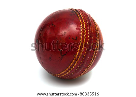 red ball cricket on a white background - stock photo