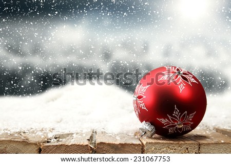 red ball on snow  - stock photo