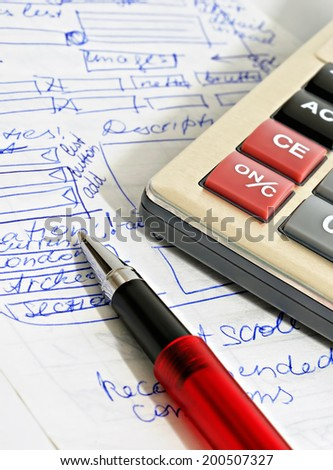 Red ball pen, calculator and sample text created especially for this photo - stock photo