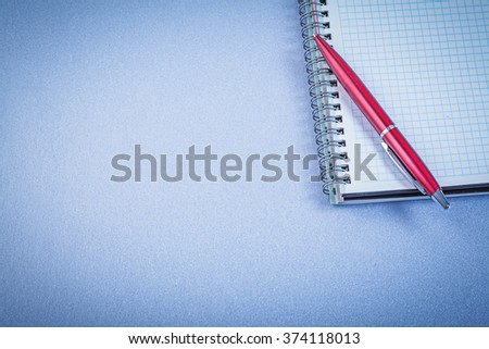 Red ball-point pen notepad office concept. - stock photo