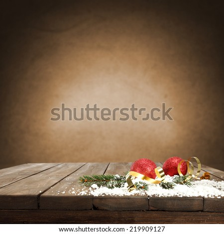 red balls and snow on top of wood  - stock photo