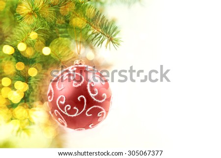 Red Balls on the Christmas Tree at the Defocused Lights Background  - stock photo