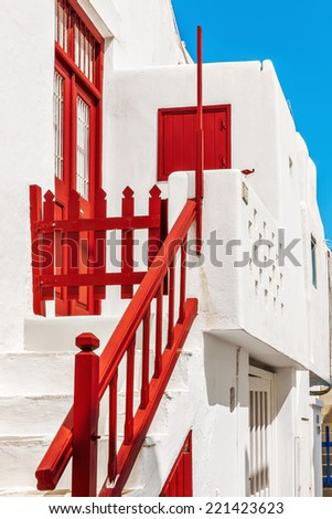Red banister and gate of a typical house in Mykonos, Cyclades, Greece - stock photo