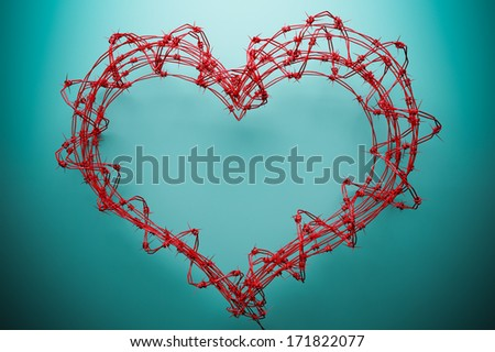 Red barbed wire heart - stock photo