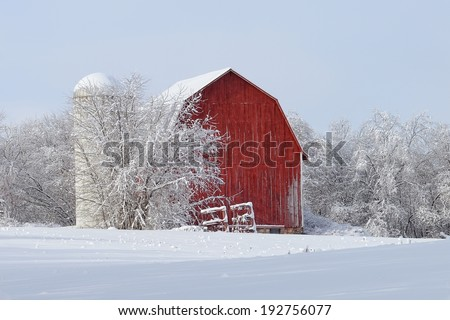 Red Barn covered with snow Winter countryside in Michigan - stock photo
