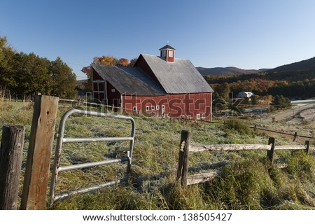 Red barn during fall foliage, Stowe, Vermont, USA - stock photo