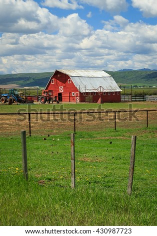 Red barn vertical image from rural Wyoming, USA. - stock photo