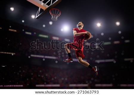 red Basketball player in action in gym - stock photo