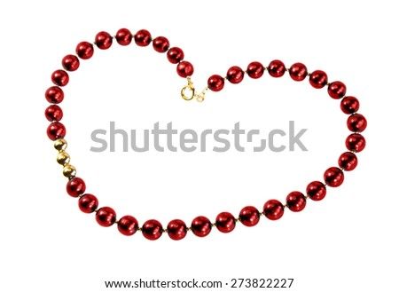 Red beads, laid in the shape of a heart - stock photo