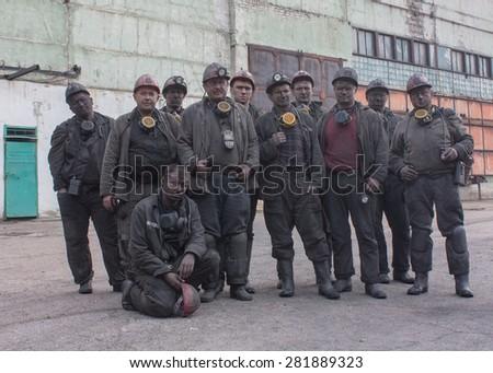 Red beam, Ukraine - August 07, 2013: Miners the mine Krasnokutskaya after work shift - stock photo