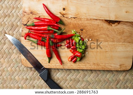 Red beautiful chilli cut slide Thai traditional way food cooking  cuisine natural hot and spicy ingredient on wicker mat - stock photo