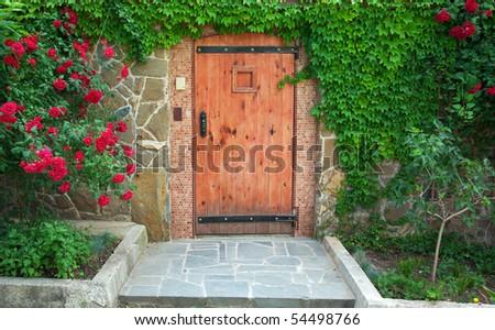 Red, beautiful door of home. Exterior design. - stock photo