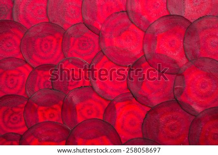 red beetred beets sliced in the background takes up the entire frame - stock photo